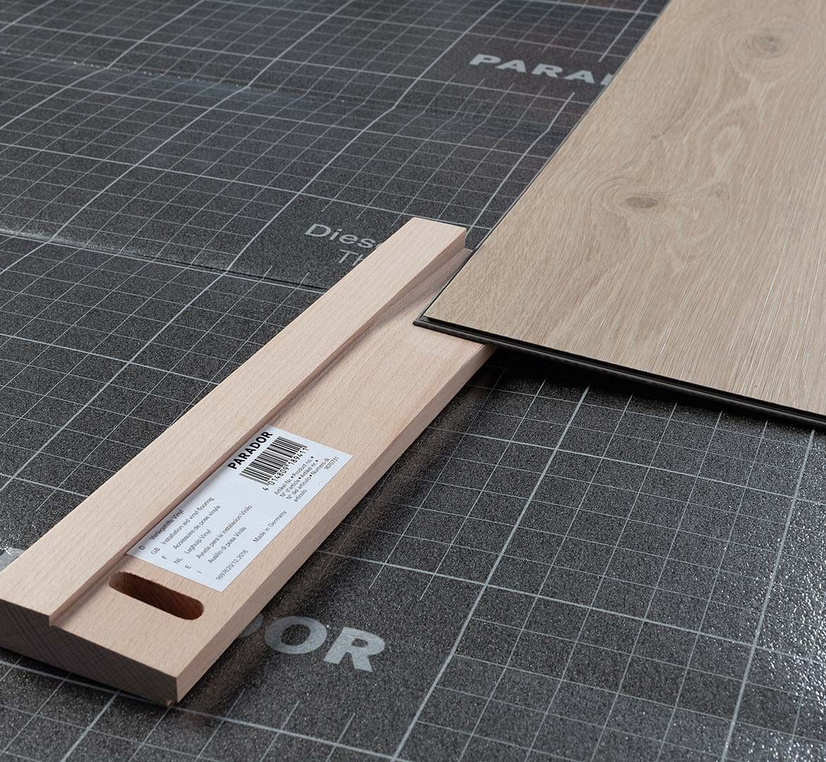 Installation aid for vinyl flooring